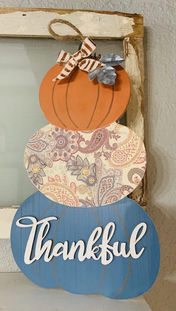 Dollar General reversible pumpkin/snowman sign