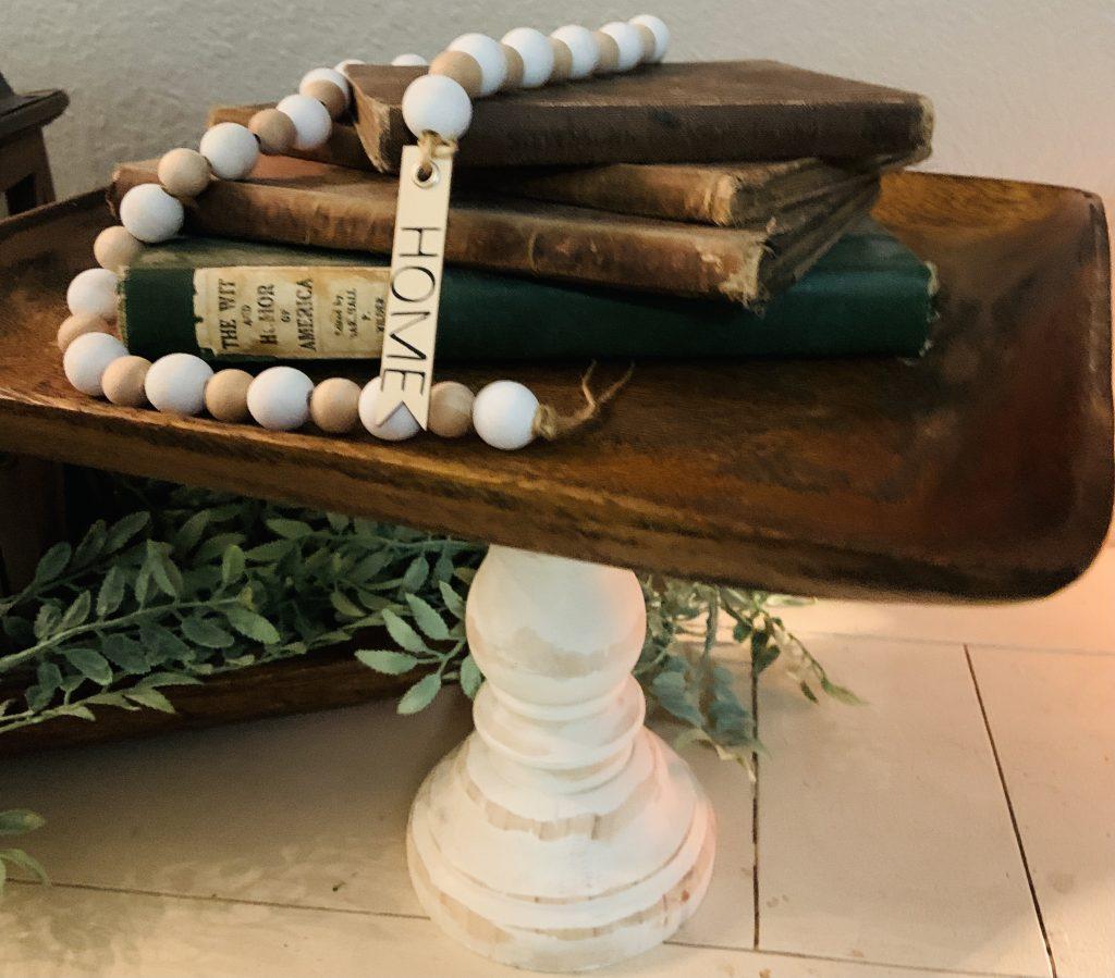 farmhouse pedestal with books on top